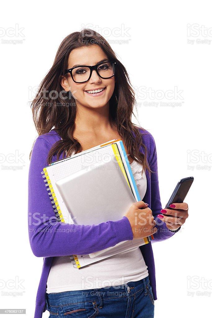 Portrait of happy mobility female student stock photo
