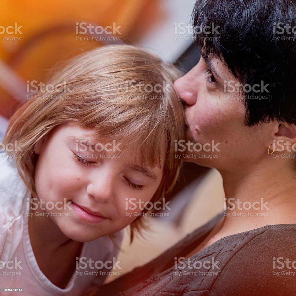 Portrait of happy mother and young daughter stock photo
