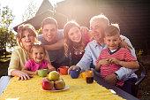 Portrait of happy multi-generation family in their garden.