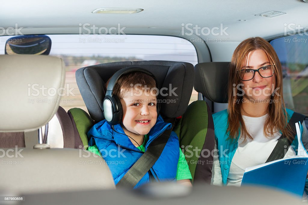 Portrait of happy passengers sitting in the car stock photo