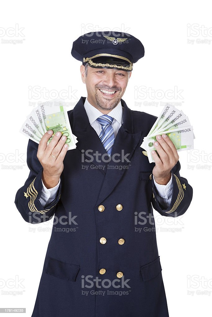 Portrait Of Happy Pilot Holding Euros royalty-free stock photo
