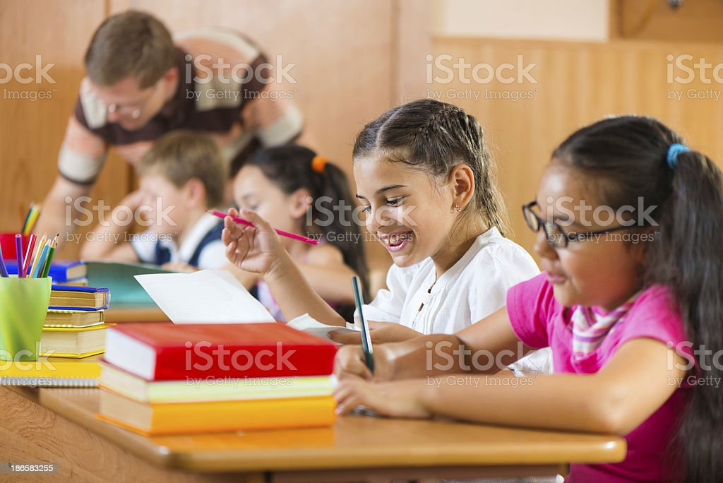 Portrait of happy pupil at lesson stock photo