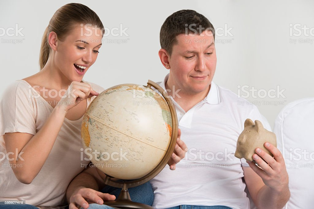 Portrait of happy romantic couple planning their vacation stock photo