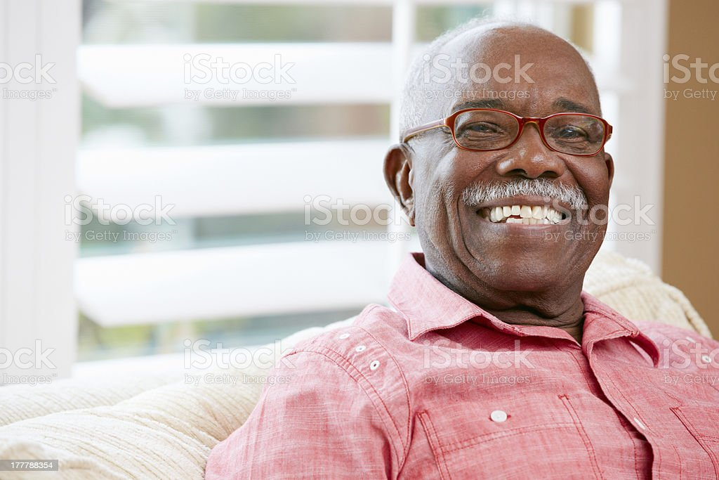 Portrait Of Happy Senior Man At Home stock photo