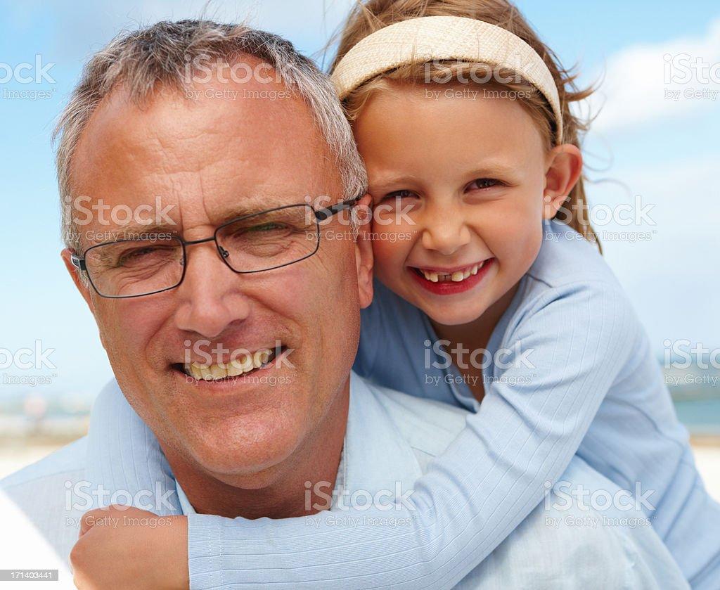 Portrait of happy senior man enjoying with his granddaughter royalty-free stock photo
