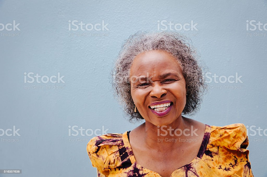Portrait of happy senior woman stock photo