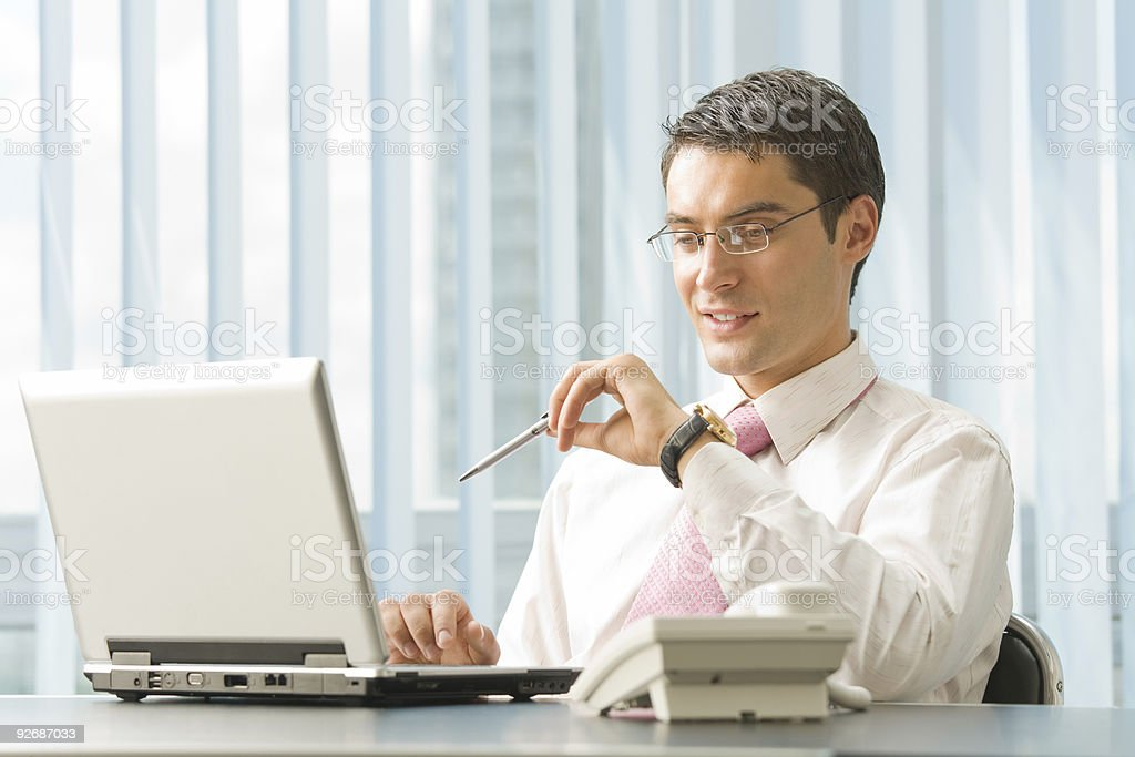 Portrait of happy smiling businessman with laptop at office royalty-free stock photo