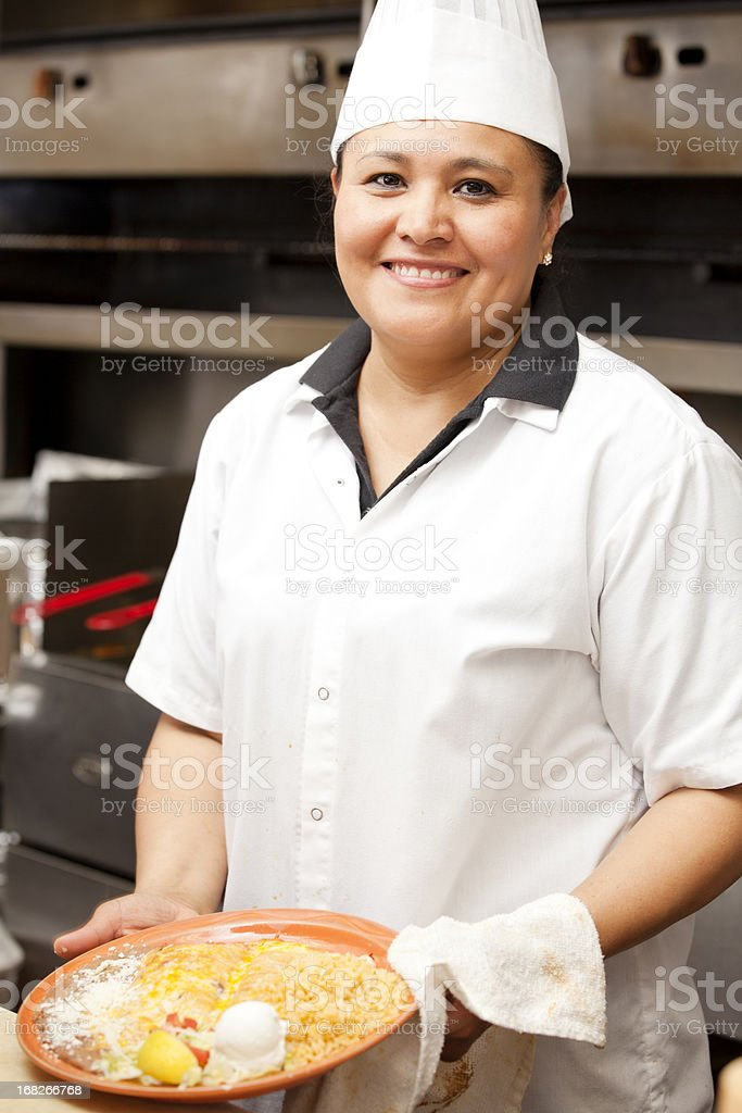 Portrait of happy smiling cook in mexican restaurant royalty-free stock photo
