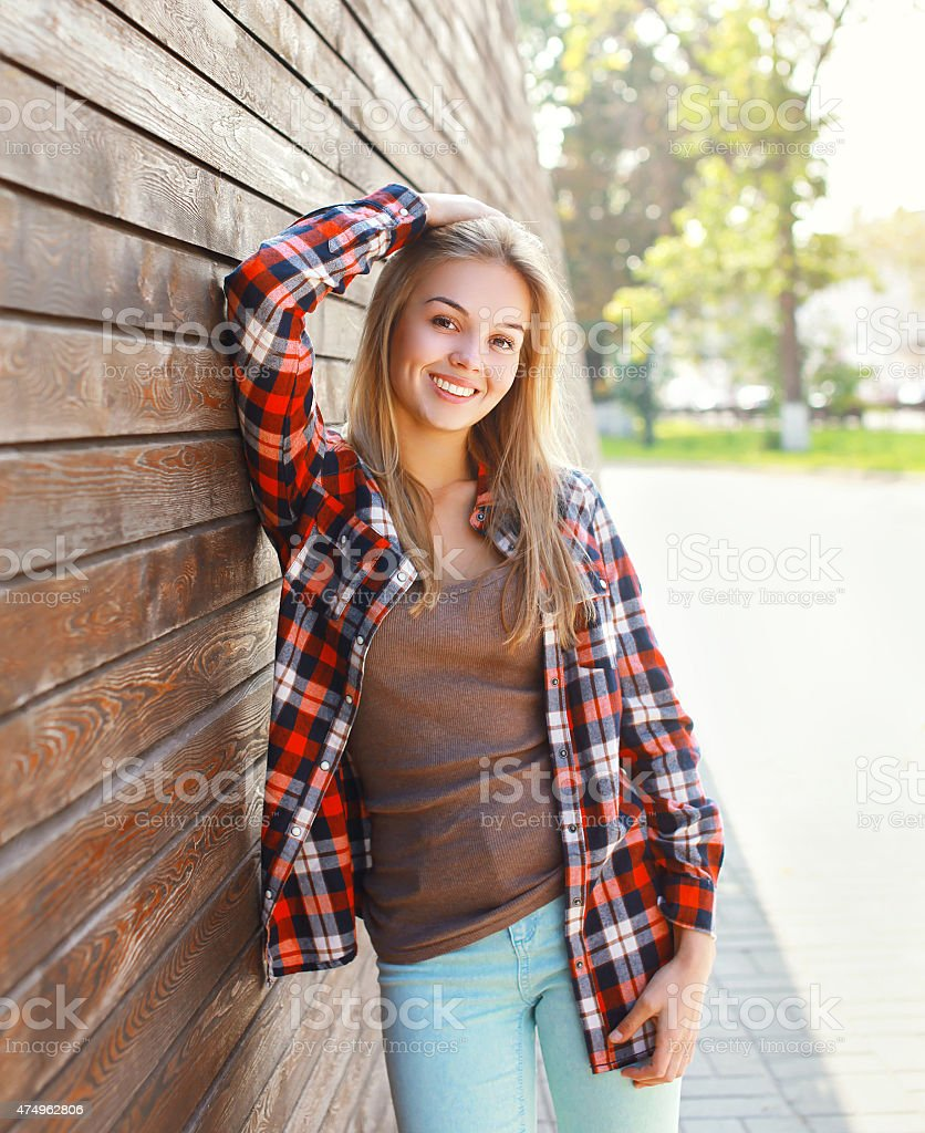Portrait of happy smiling young woman wearing a casual clothes stock photo