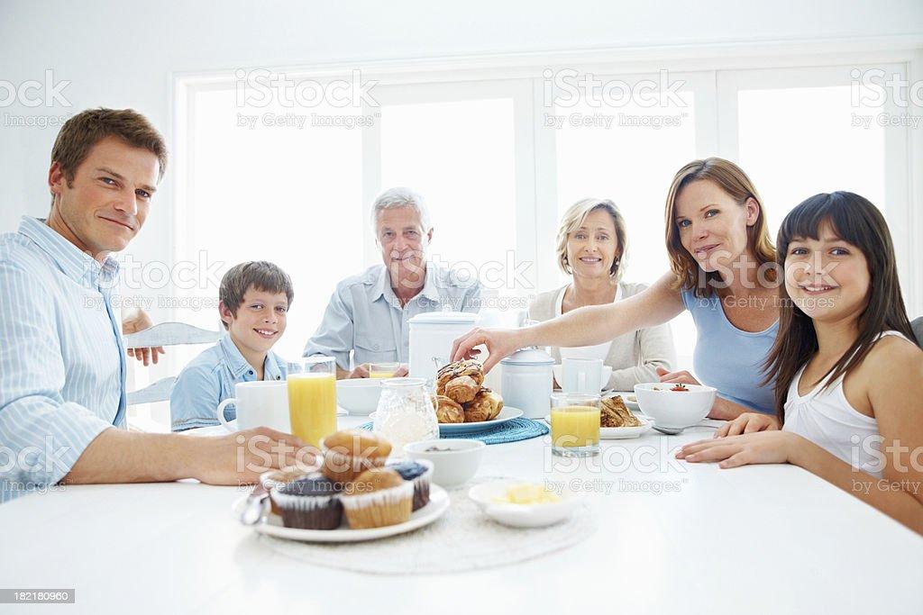 Portrait of happy three generational family having breakfast royalty-free stock photo