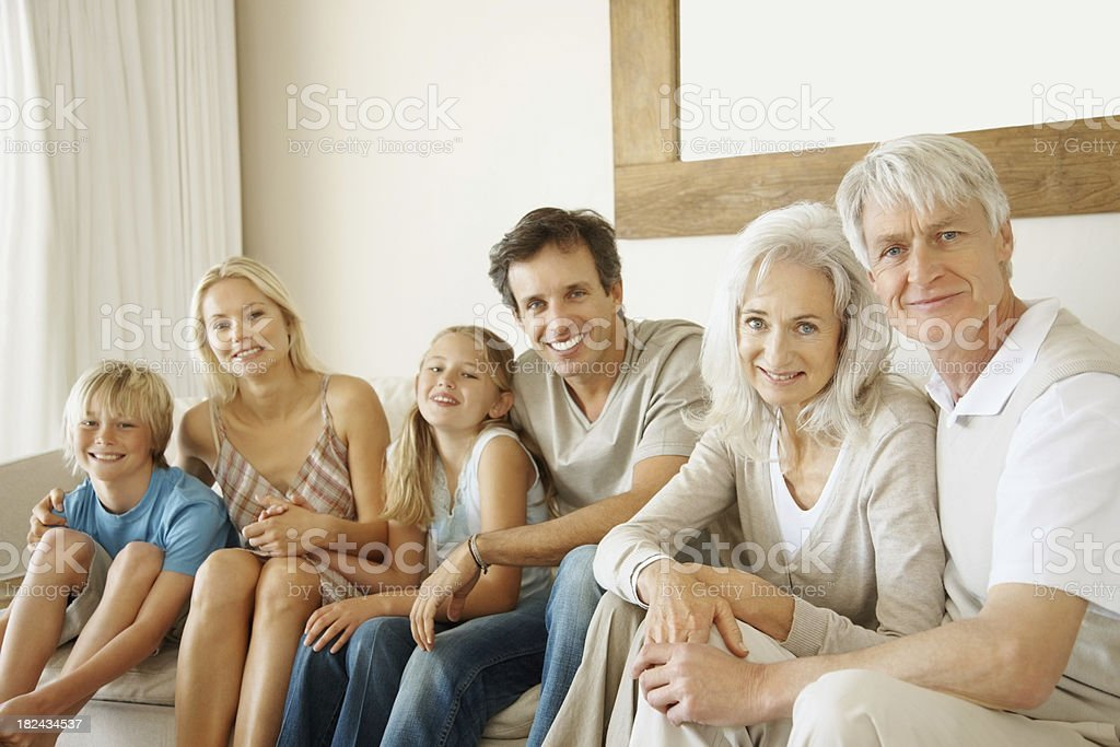 Portrait of happy three generational family sitting together royalty-free stock photo