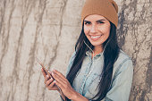 Portrait of happy trendy hipster woman  listening music on  phone