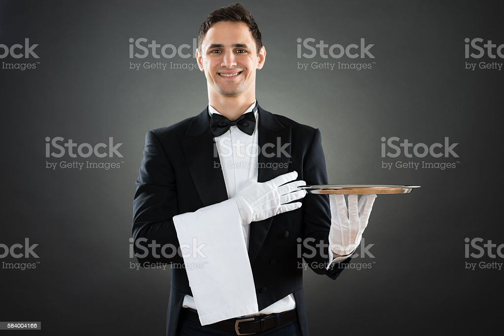 Portrait Of Happy Waiter With Empty Tray And Towel stock photo