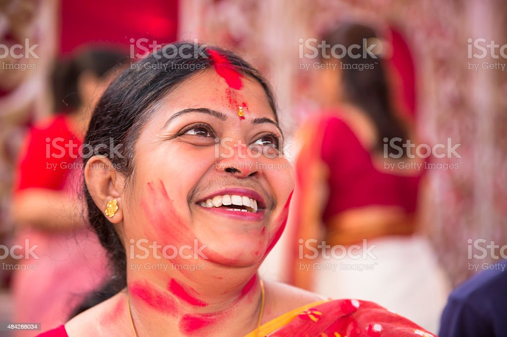 Portrait of happy woman after applying Vermilion during Durga Puja stock photo