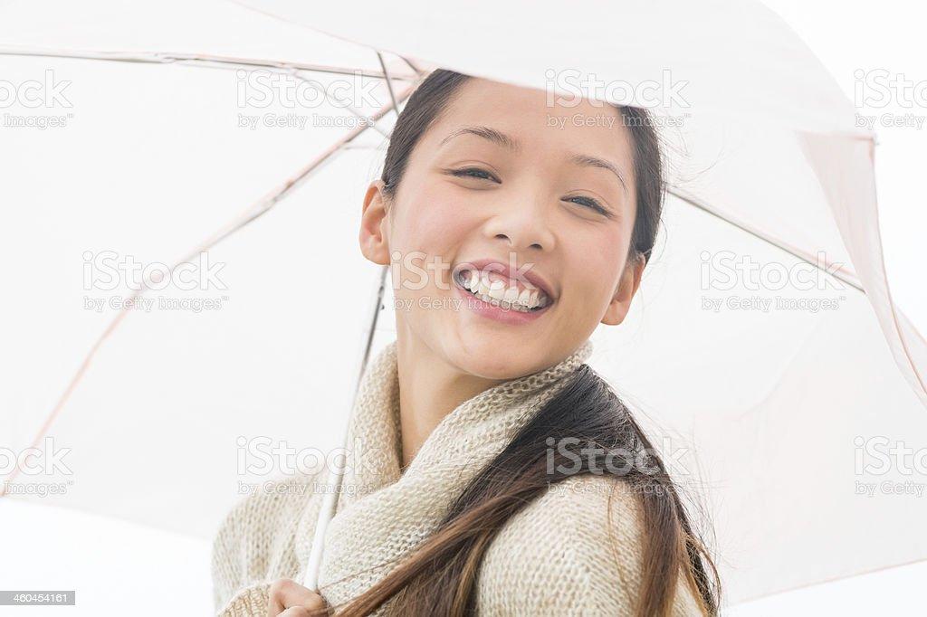 Portrait Of Happy Woman Holding Umbrella royalty-free stock photo