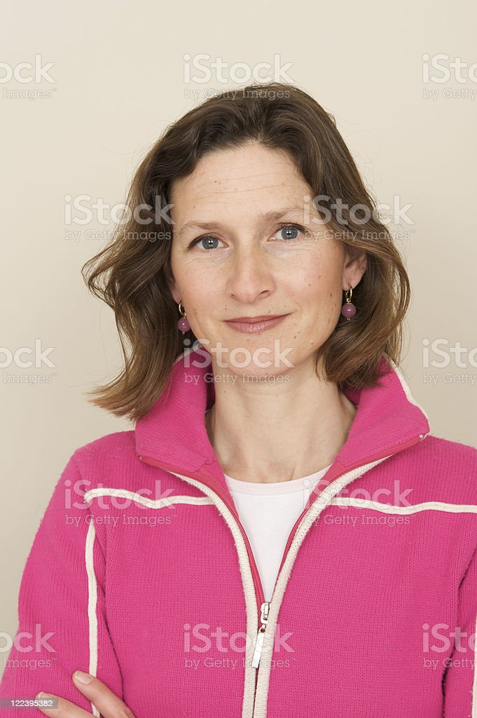 portrait of happy woman in pink royalty-free stock photo