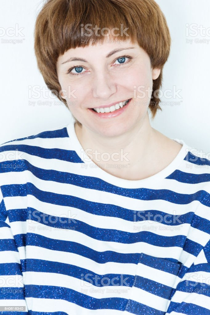 Portrait of happy woman with short brown hair stock photo