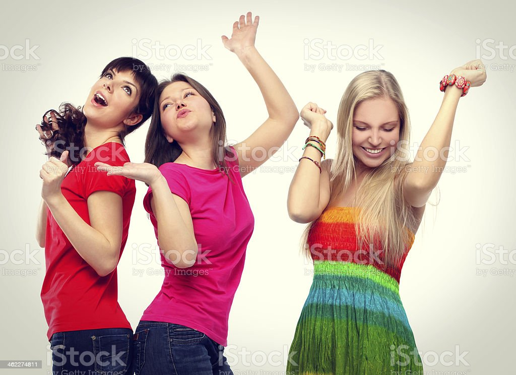 Portrait of happy young adult women dancing stock photo