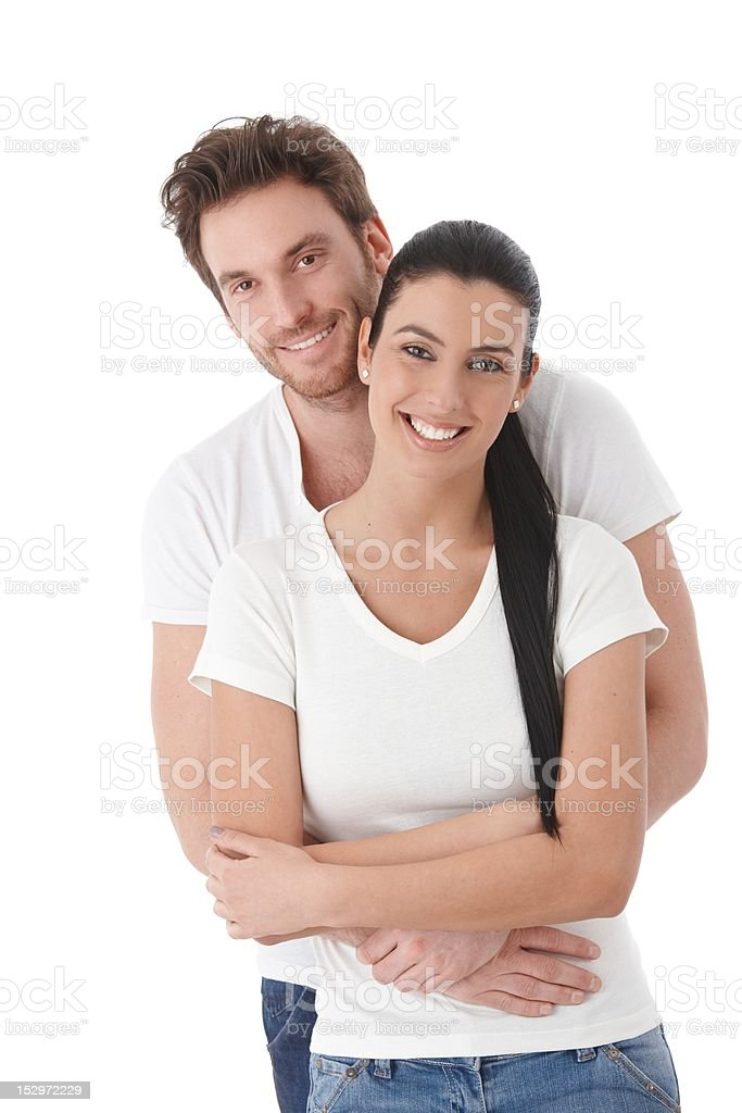 Portrait of happy young couple smiling royalty-free stock photo