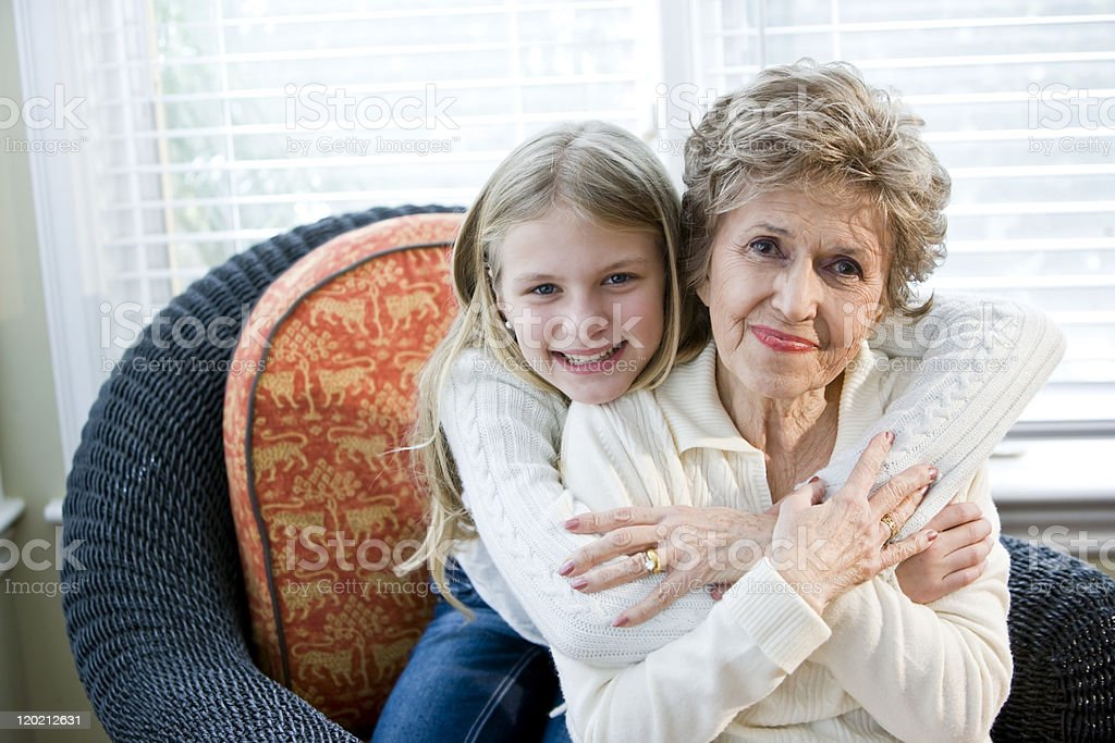 Portrait of happy young girl hugging grandmother royalty-free stock photo