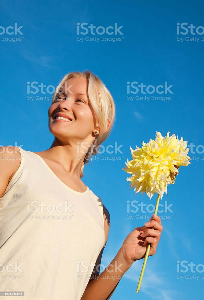 Portrait of happy young girl with dahlia royalty-free stock photo
