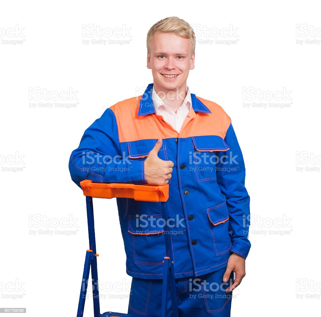 Portrait of happy young man showing thumb up, standing at stock photo