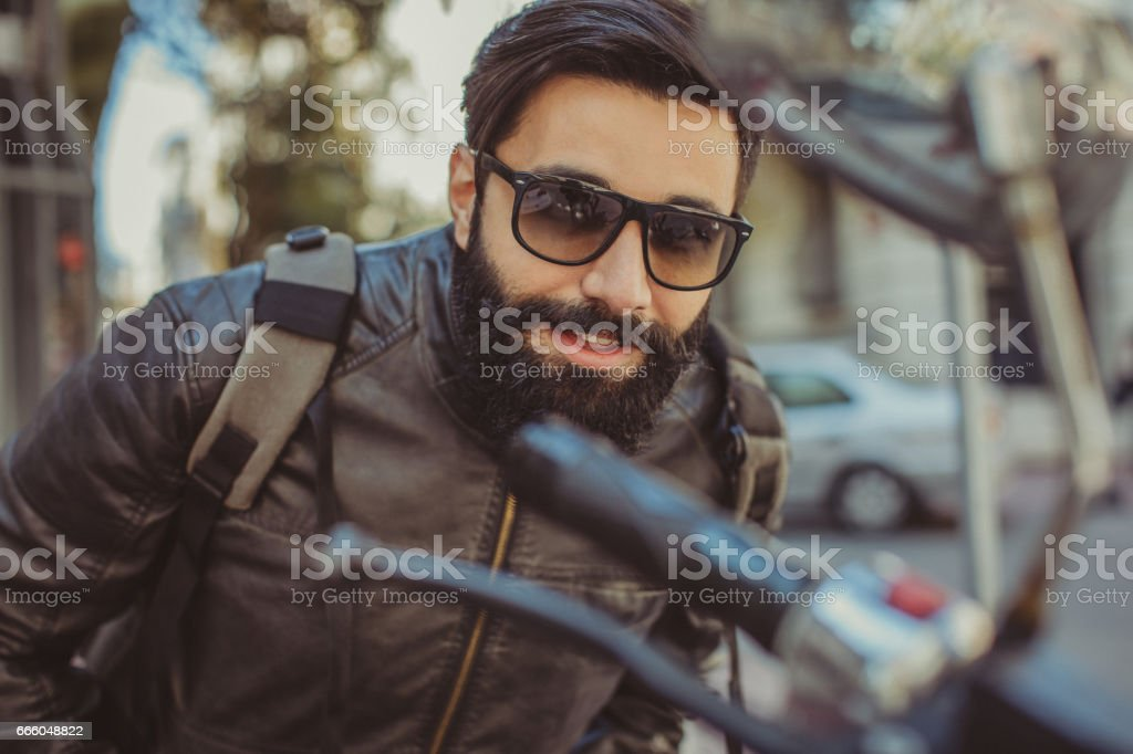 Portrait of happy young man with long beard stock photo