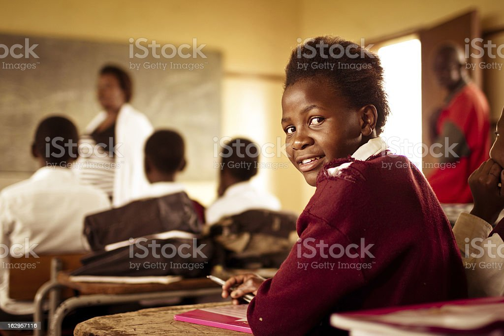 Portrait of happy Young South African girl in classroom stock photo