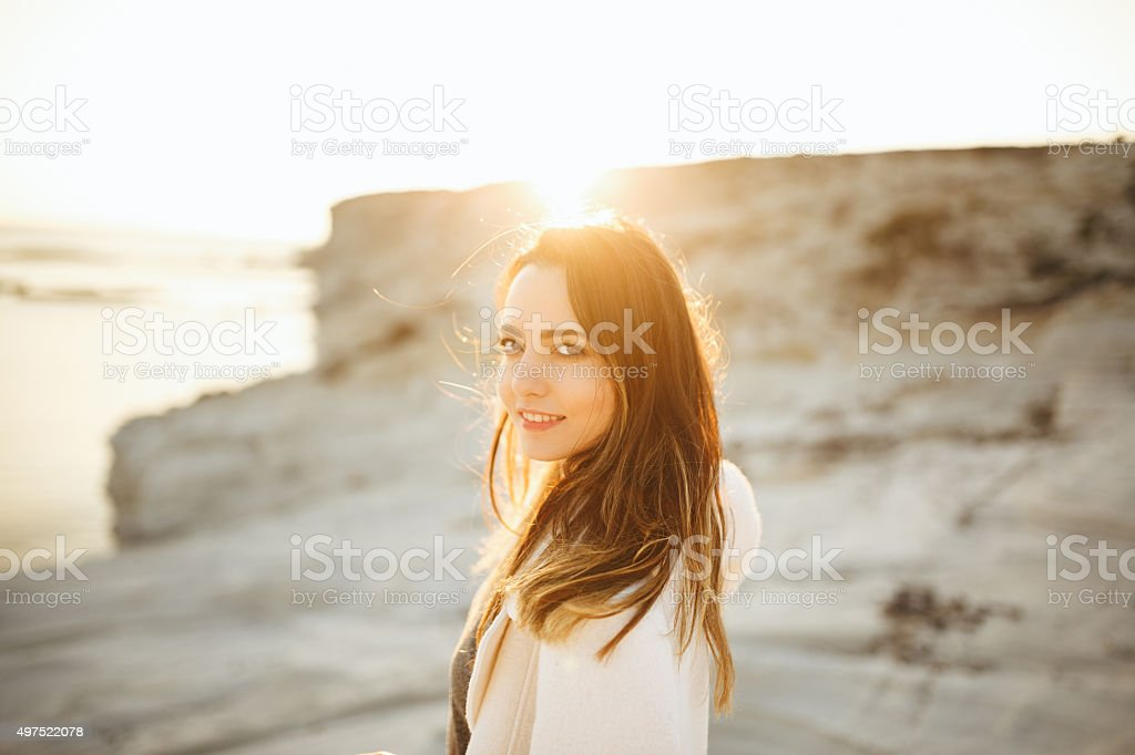 Portrait of happy young woman looking away stock photo