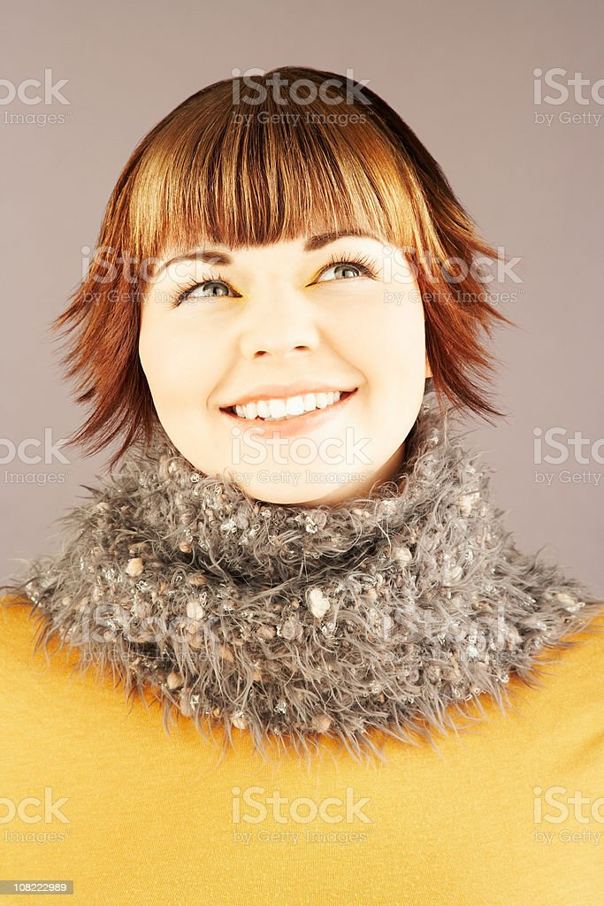Portrait of Happy Young Woman Wearing Cozy Scarf royalty-free stock photo