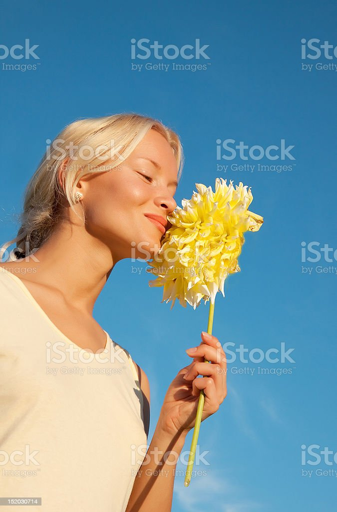 Portrait of happy young woman with flower royalty-free stock photo