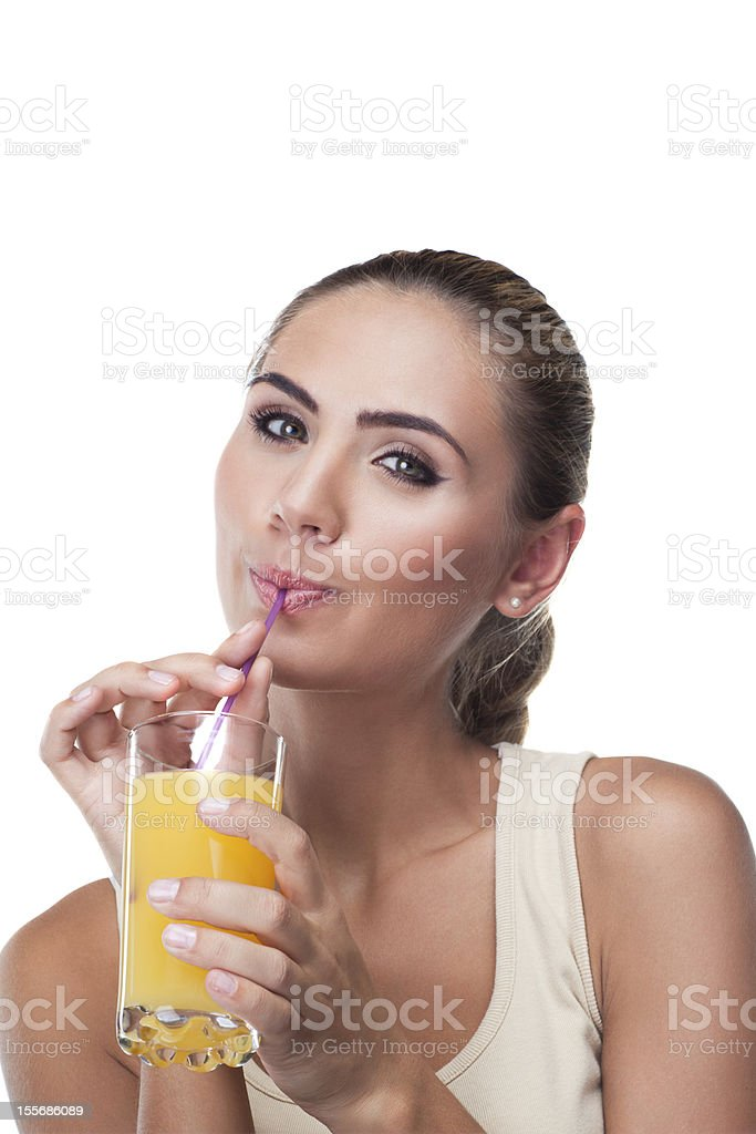 Portrait of happy young woman with juice on white backg royalty-free stock photo