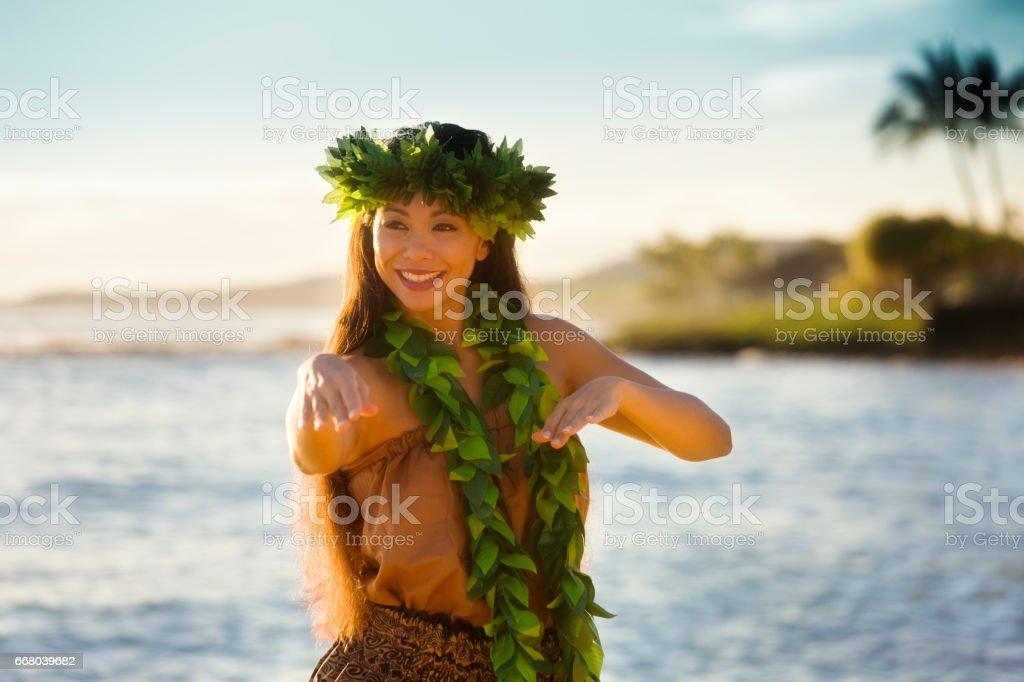 Portrait of Hawaiian Hula Dancer Dancing on the Beach stock photo