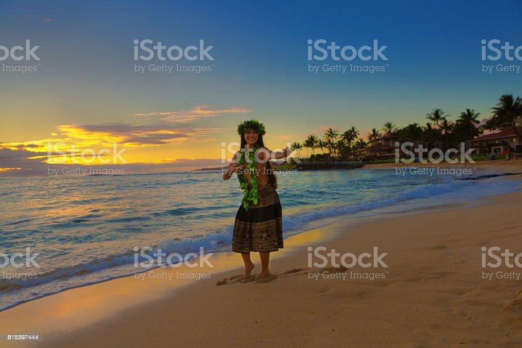Portrait of Hawaiian Hula Dancer on the Beach at Sunset stock photo