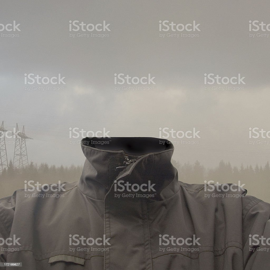 Portrait of headless man with grey clouds in background stock photo