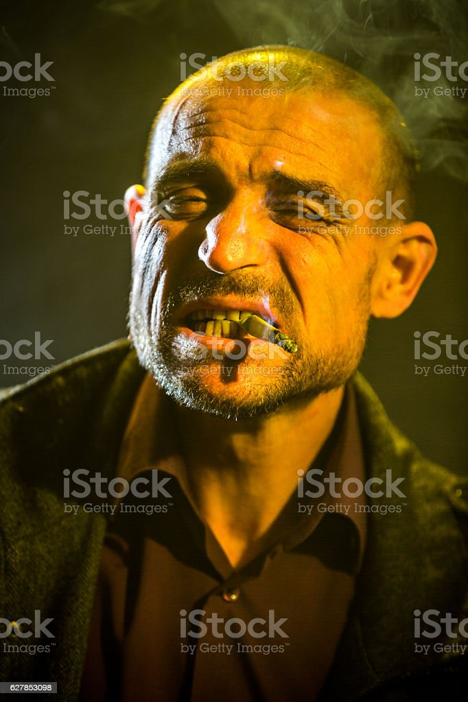 Portrait Of Heavy Smoker stock photo