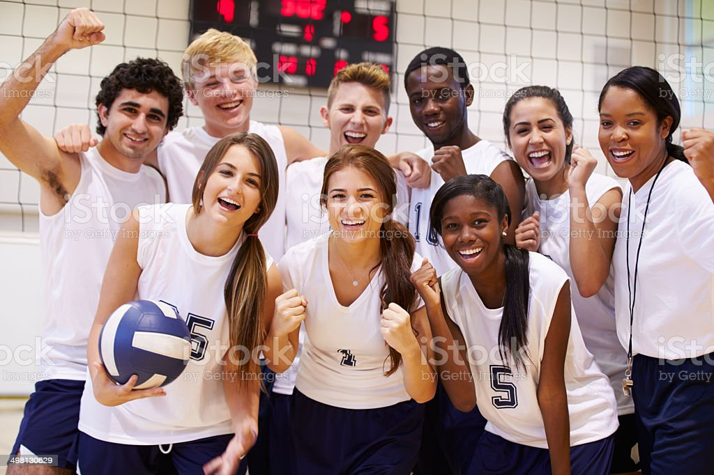 Portrait Of High School Volleyball Team Members With Coach stock photo
