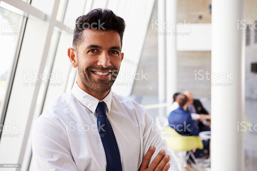 Portrait Of Hispanic Businessman In Modern Office stock photo