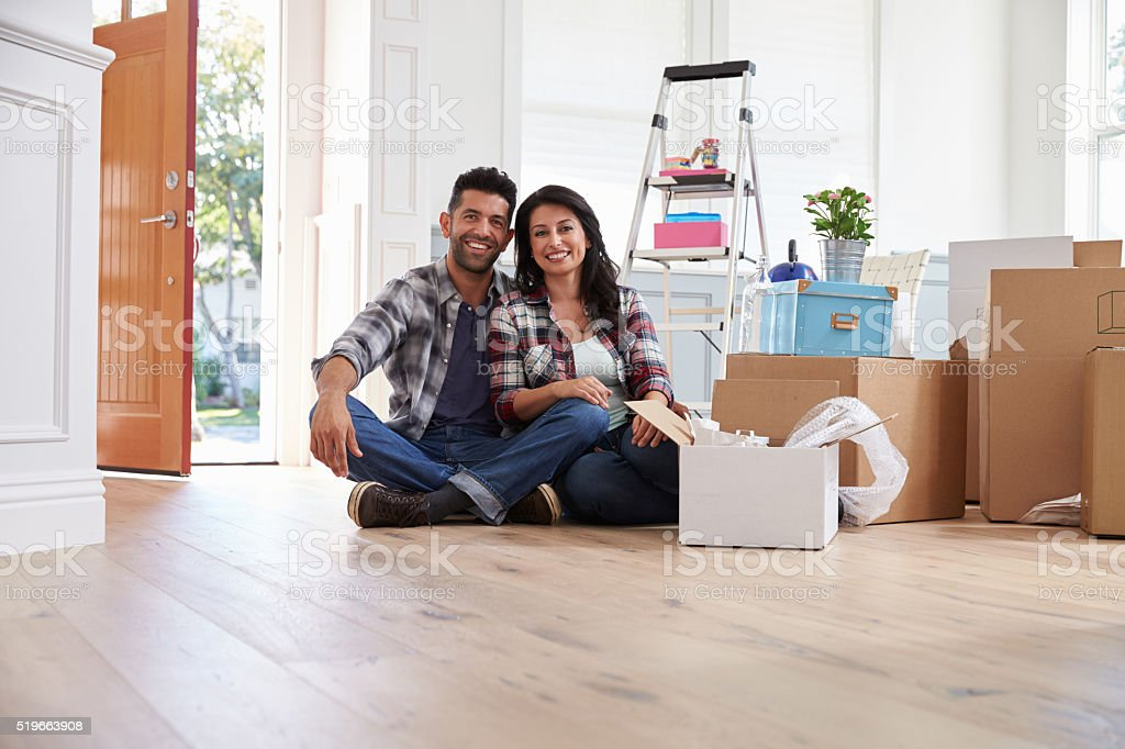 Portrait Of Hispanic Couple Moving Into New Home stock photo