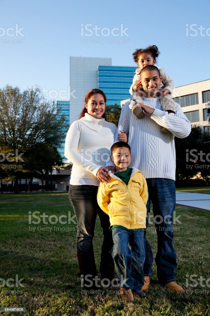 Portrait of Hispanic family at city park royalty-free stock photo