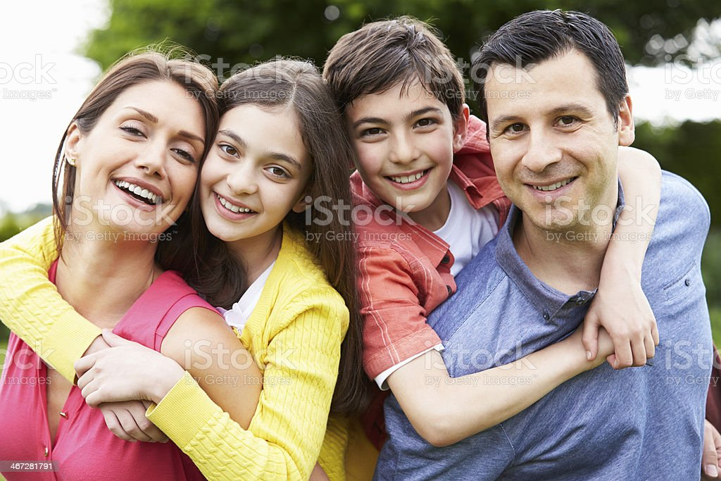 Portrait Of Hispanic Family In Countryside stock photo