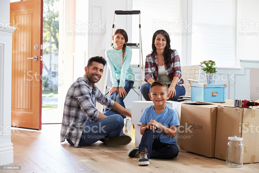 Portrait Of Hispanic Family Moving Into New Home stock photo