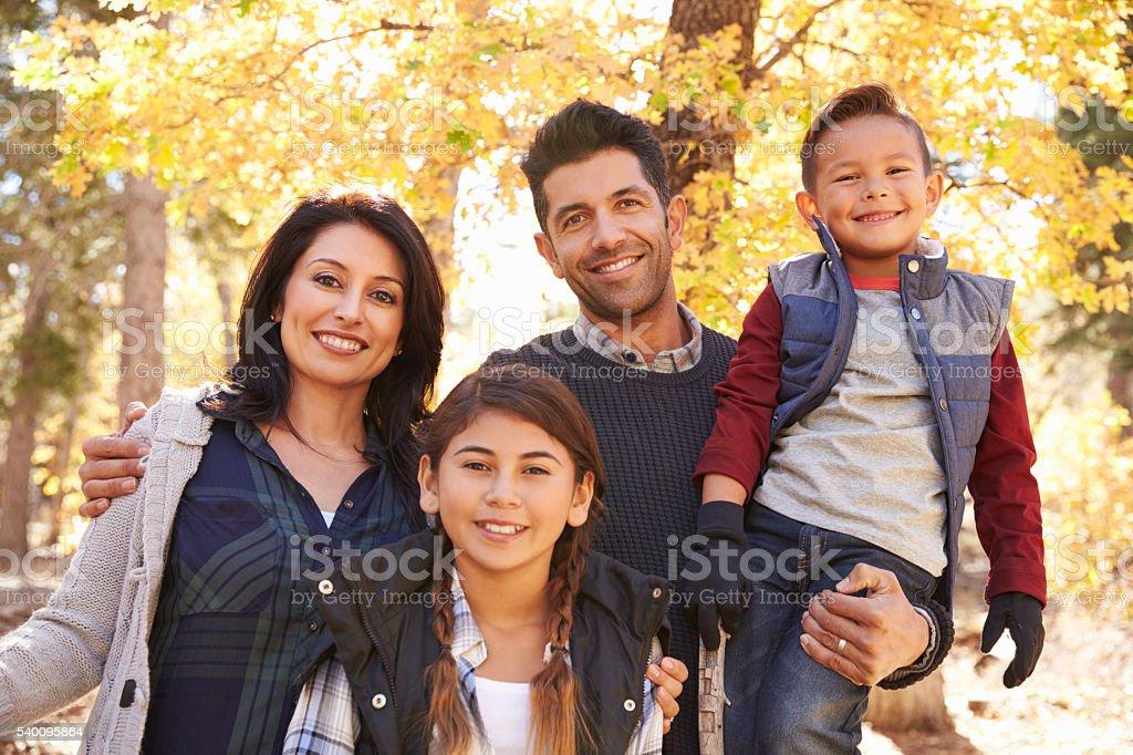 Portrait of Hispanic family outdoors looking at camera stock photo