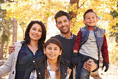 Portrait of Hispanic family outdoors looking at camera