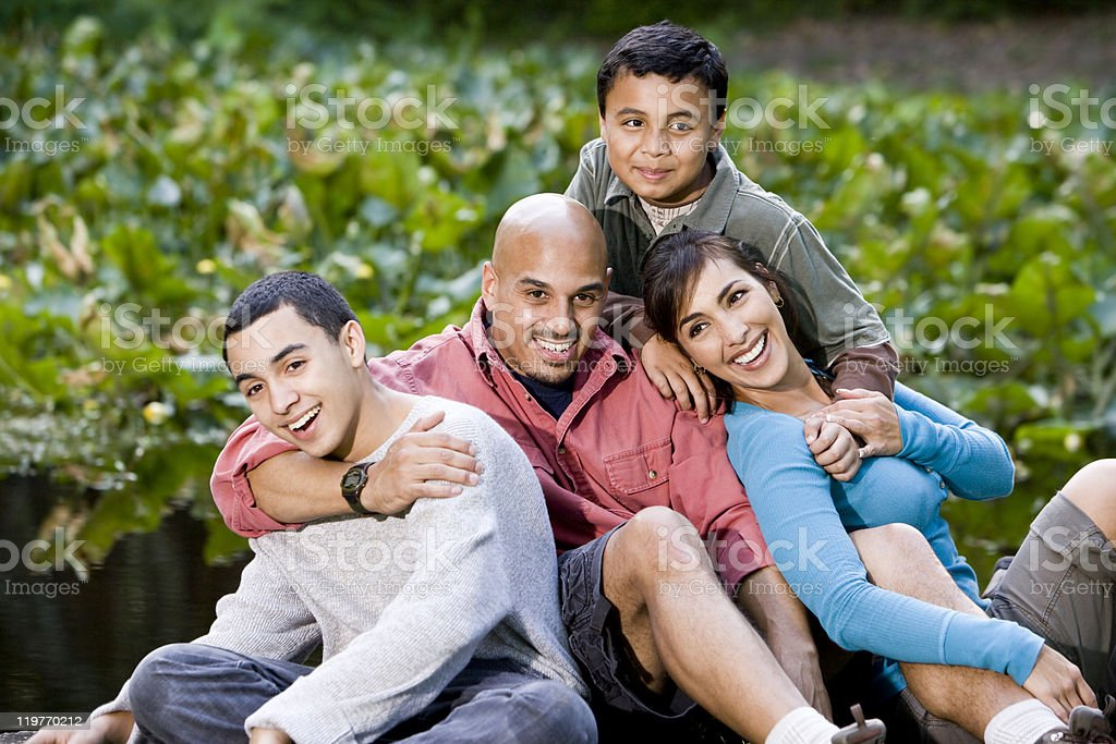 Portrait of Hispanic family with two boys outdoors royalty-free stock photo