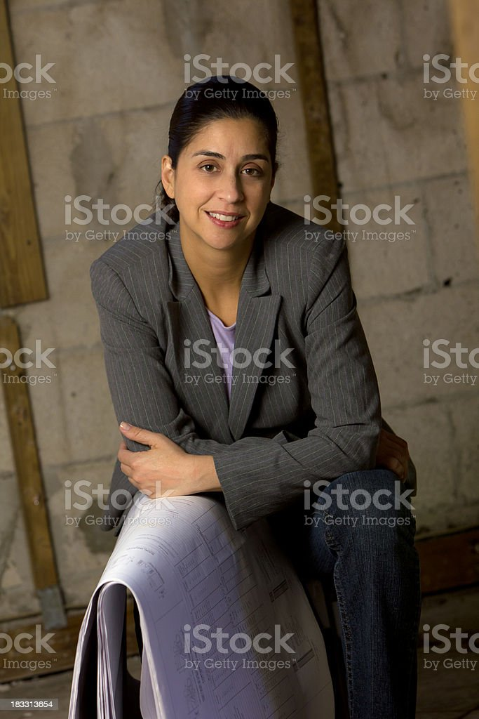 Portrait of hispanic female architedt or engineer on site royalty-free stock photo