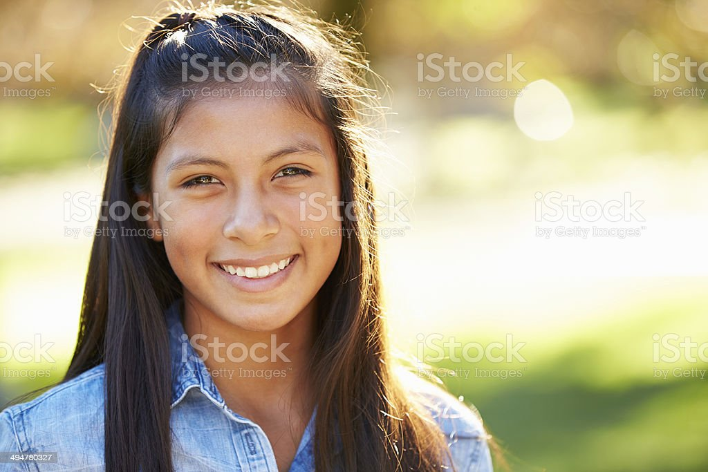 Portrait Of Hispanic Girl In Countryside stock photo