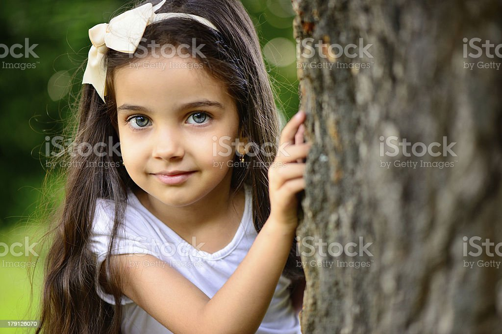 Portrait of hispanic girl in sunny park royalty-free stock photo