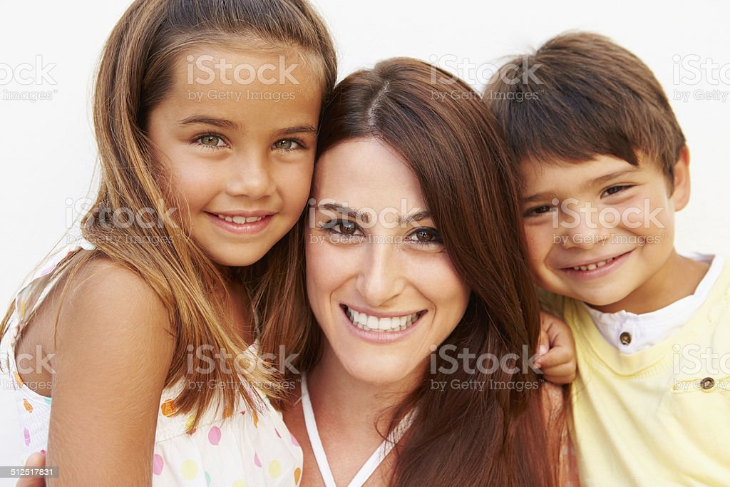 Portrait Of Hispanic Mother With Children stock photo