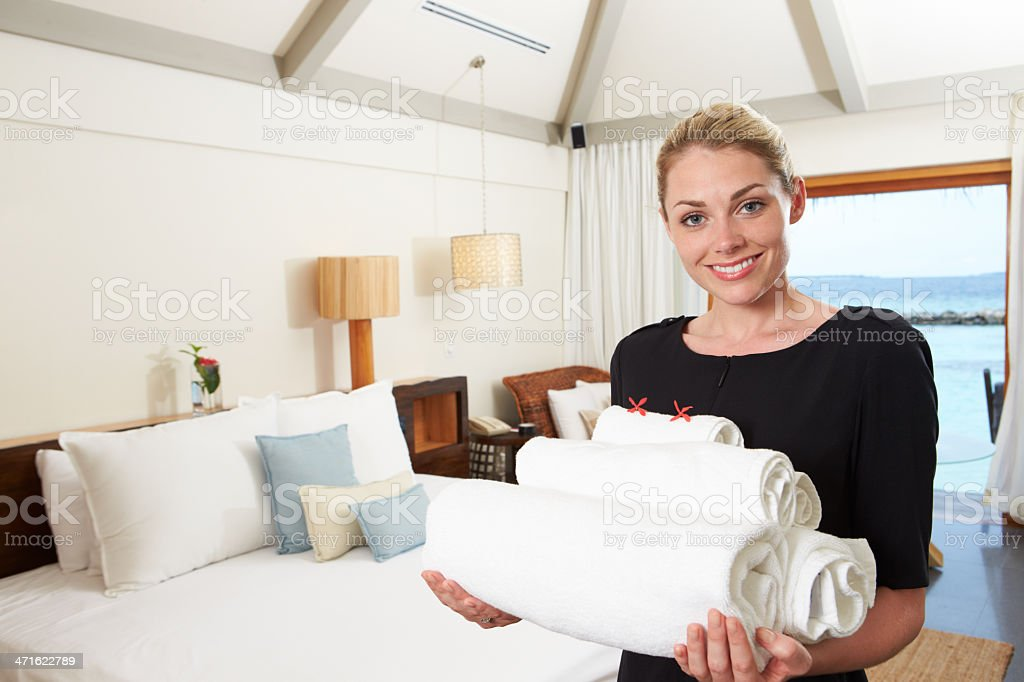 Portrait Of Hotel Chambermaid With Towels stock photo